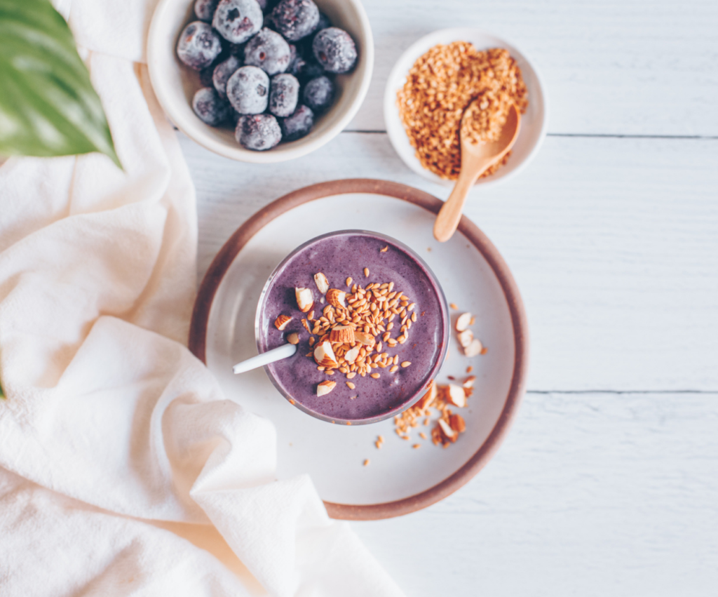 nutritious smoothie bowl with blueberries and flax seeds