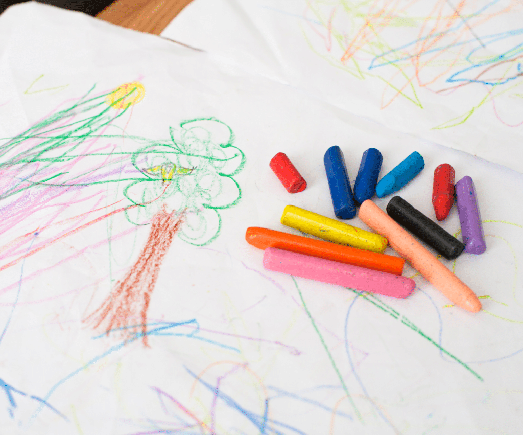 baby coloring crayons and paper