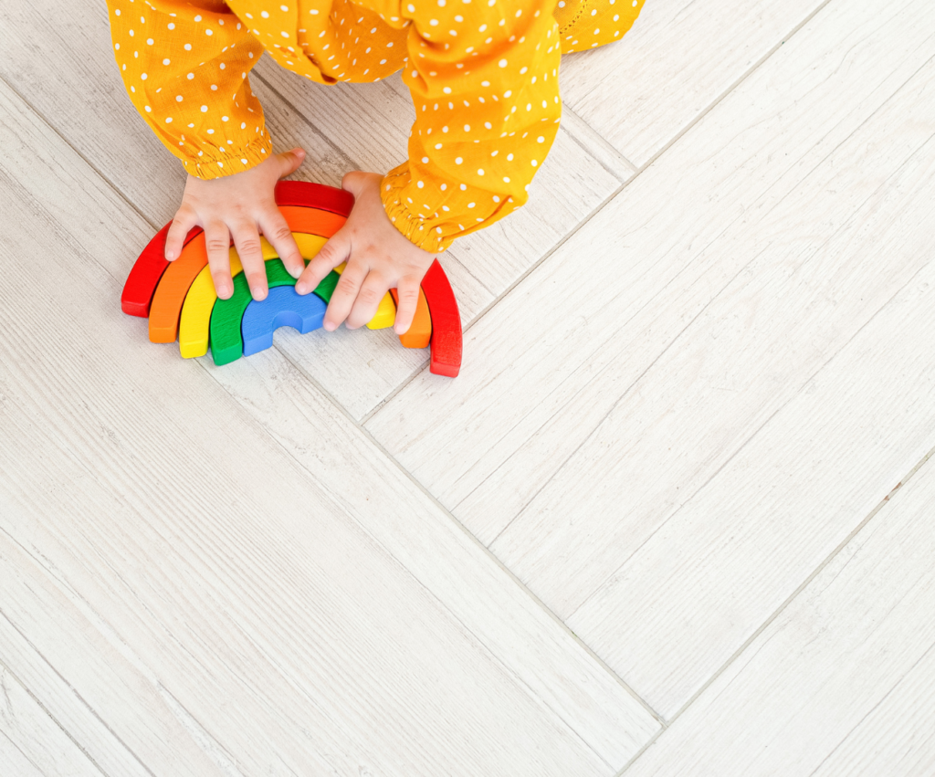 baby playing with rainbow stacking blocks