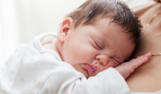 mom with newborn baby sleeping