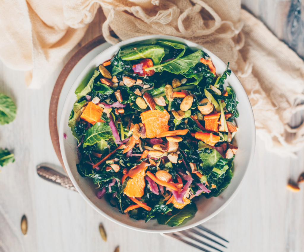 big bowl of kale salad with oranges