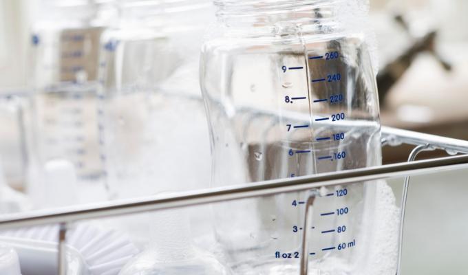 glass bottles in the drying rack