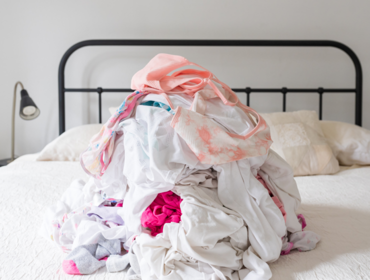 pile of laundry on the bed