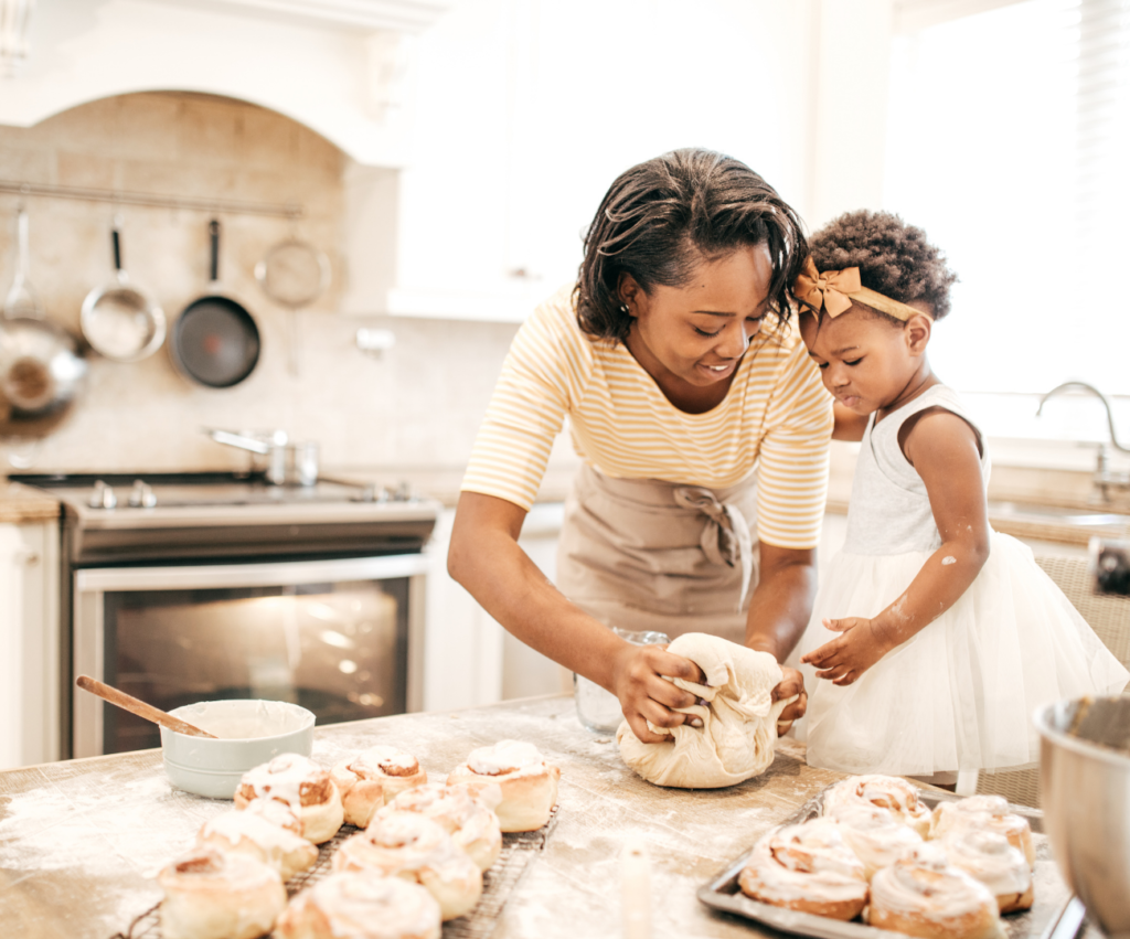 mom and toddler baking