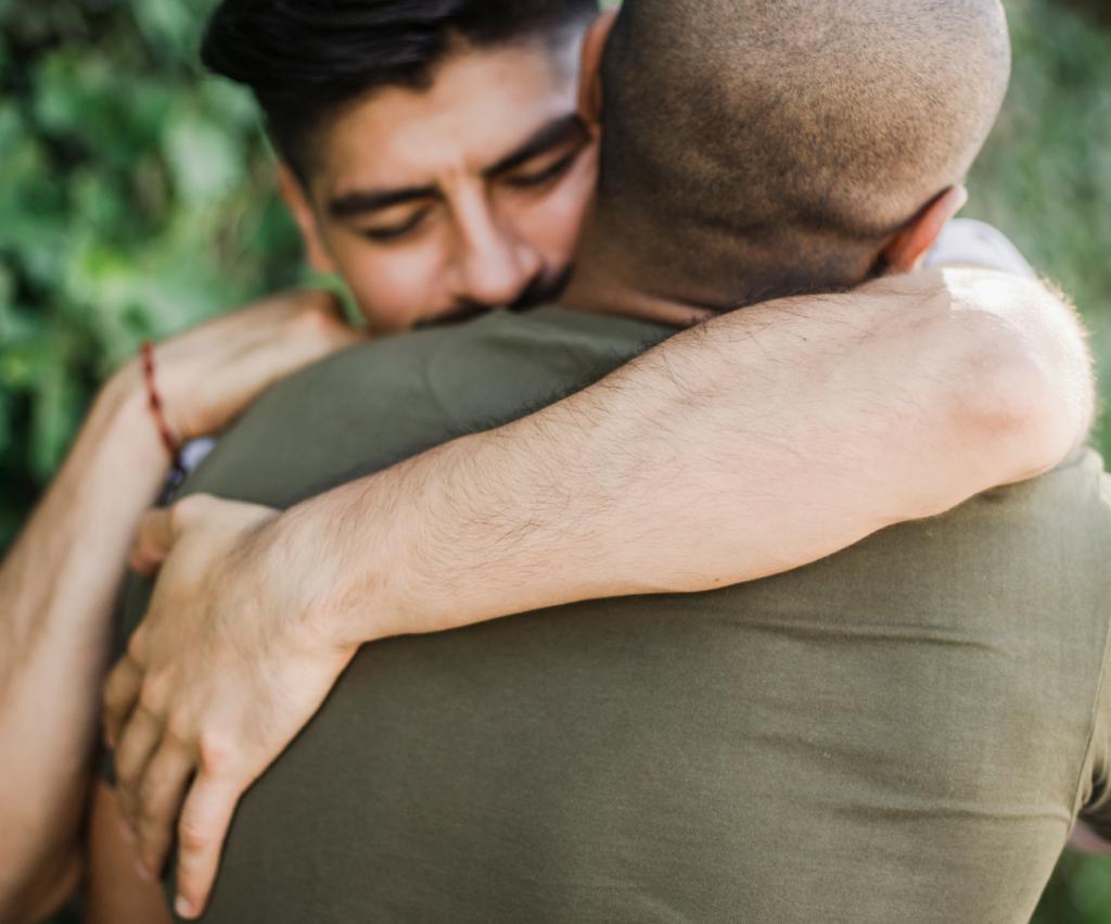 two male friends hugging