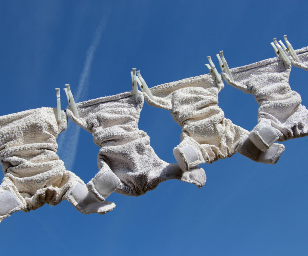 cloth diapers drying on clothes line
