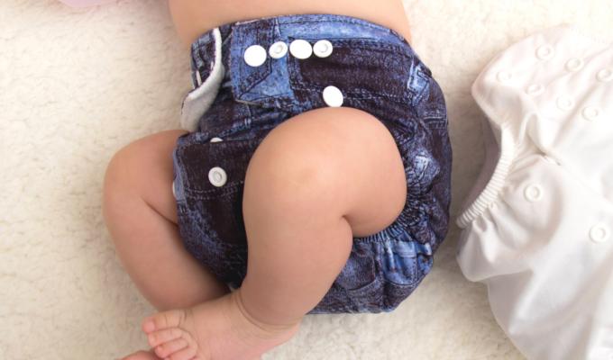baby in tie dye cloth diaper