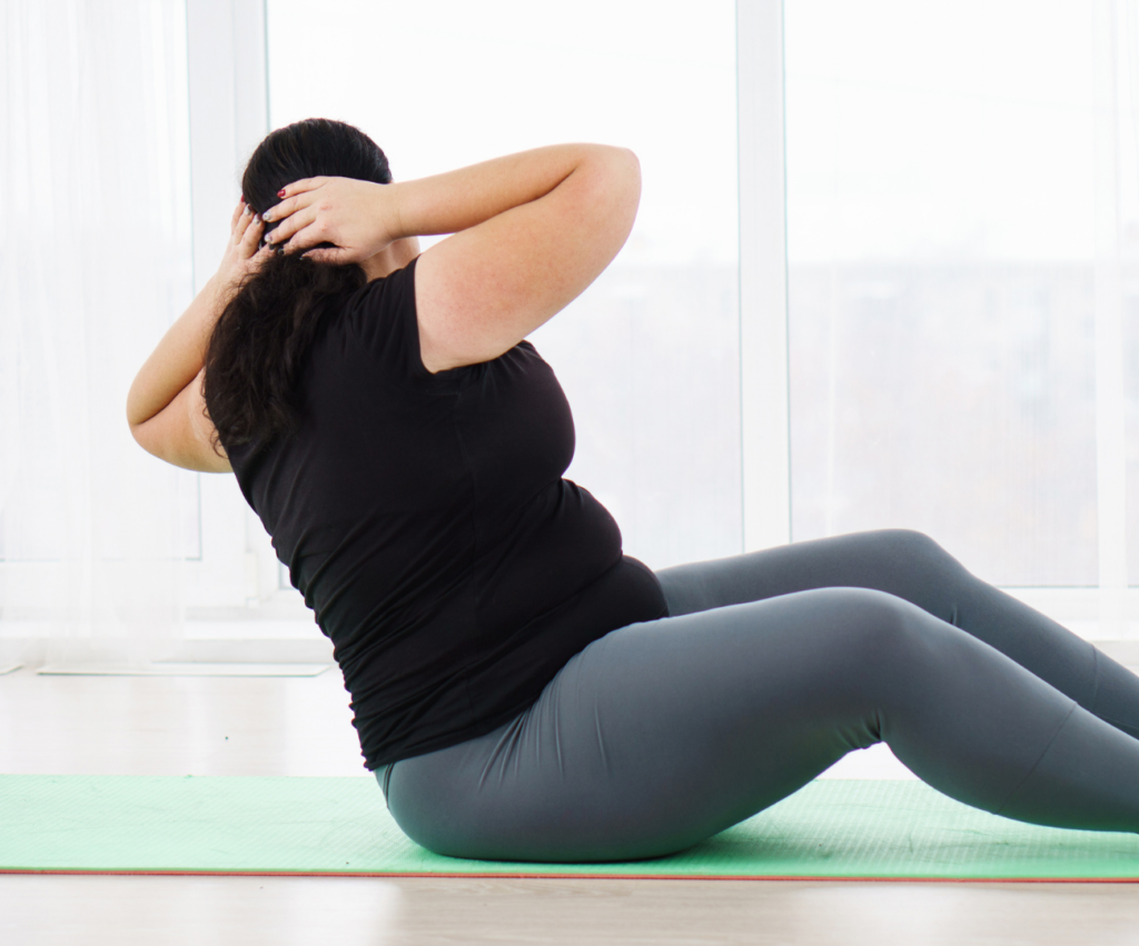 woman on a yoga mat doing abdominal twists
