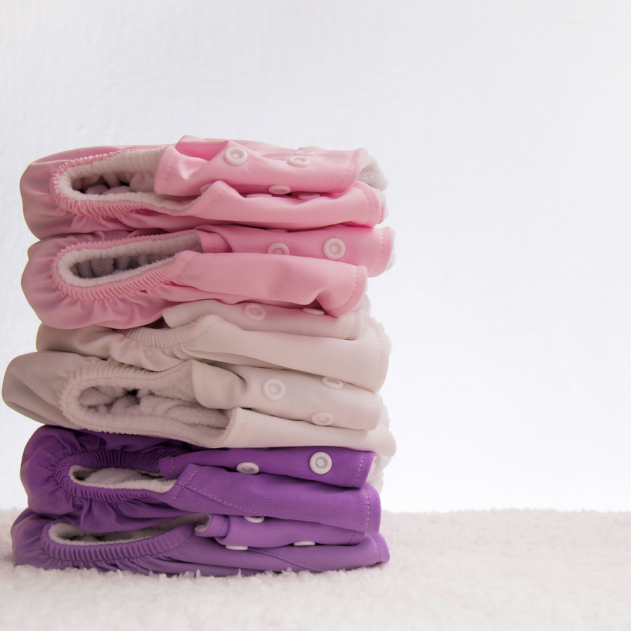 stack of six colorful cloth diapers