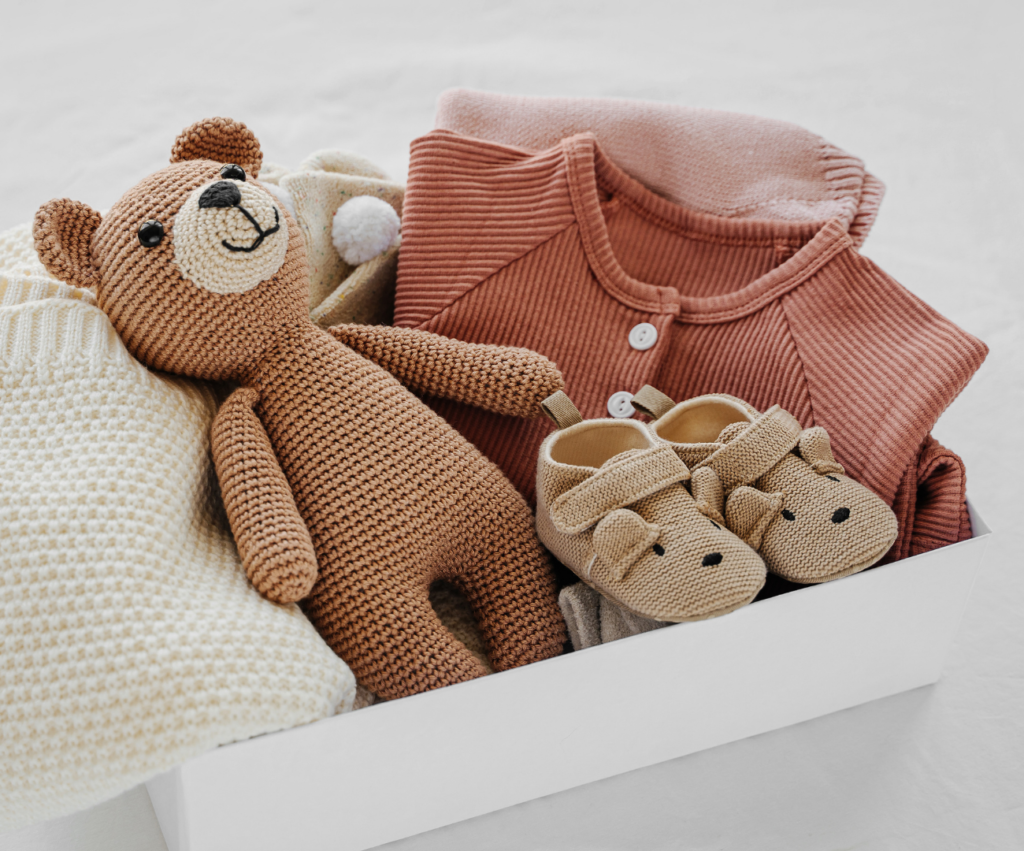 box of knit baby items