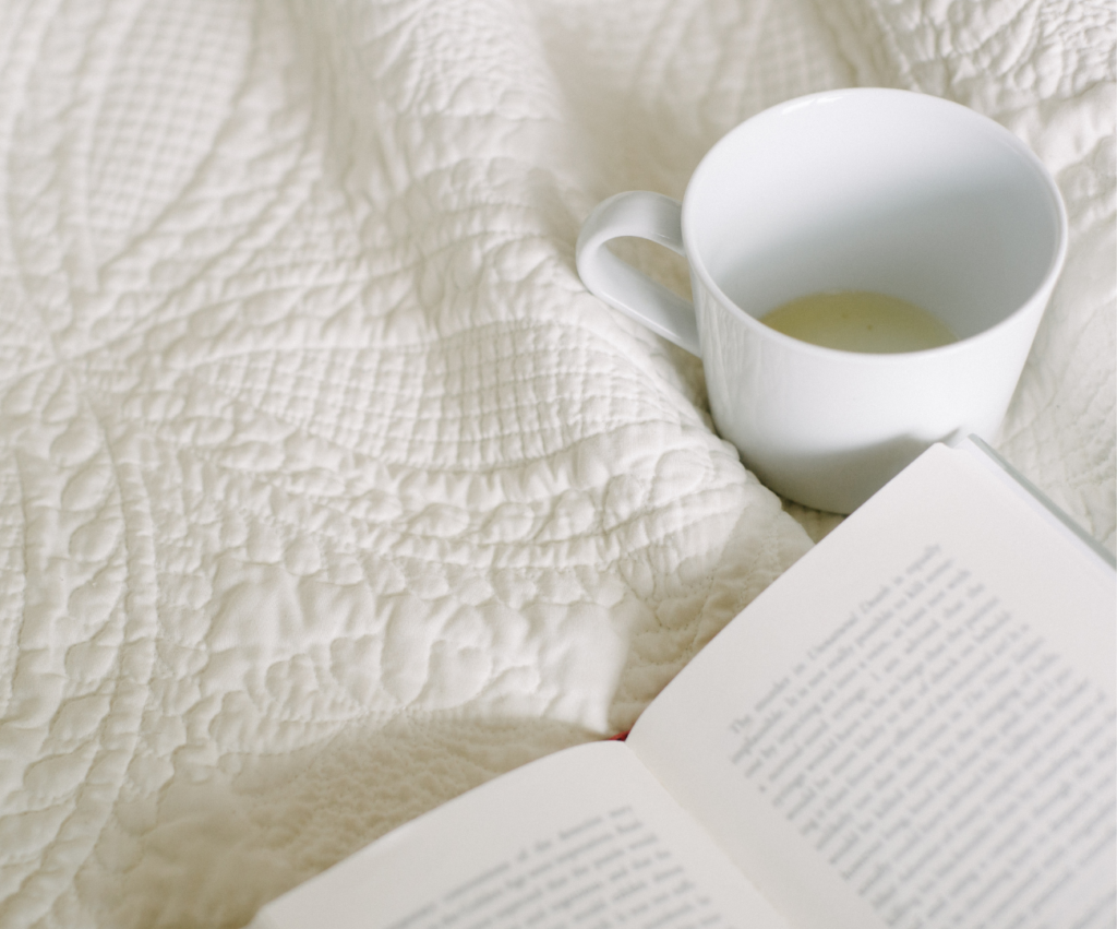 book and mug of tea on a quilt