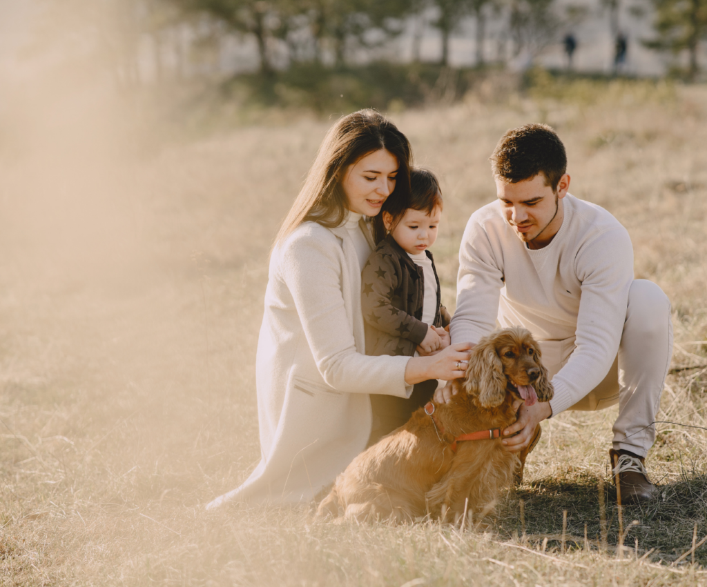 family of four in the field
