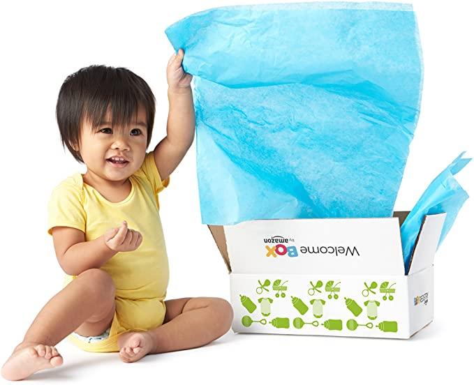 baby opening cardboard box