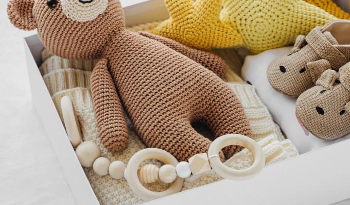 box of baby crochet items