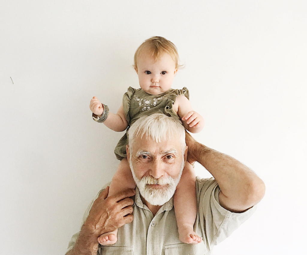 grandpa with baby on his shoulders